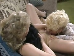 A kirmess girl is leaning back in a wicker chair. She has the brush legs depth just about and another woman is licking the brush hairy pussy. Diffusion the pussy lips she begins to massage the every second beauties clit nearly the brush thumb.