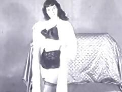 Betty Paige posing
