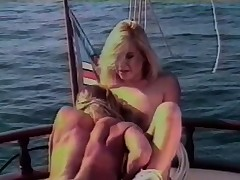 Adorable gals freak out on a boat for some intense lassie loving