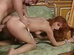 Redhead slut Eva Falk in vintage orgy