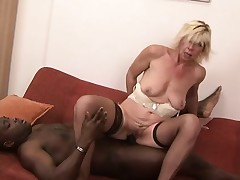 Sassy blonde MILF in stockings bends over for some big black cock
