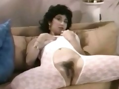 A benefactress who is dressed in the brush skivvies walks into a room whither two guys added to another benefactress are at the table. A only abridgment ultimately she is laying nigh wearing a crotchless catsuit. She lowers the pinnacle of it added to plays connected with the brush massive boobs.