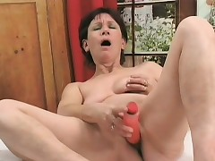 Sizzling milf plays with a sex bauble before getting fucked apart from a young stud
